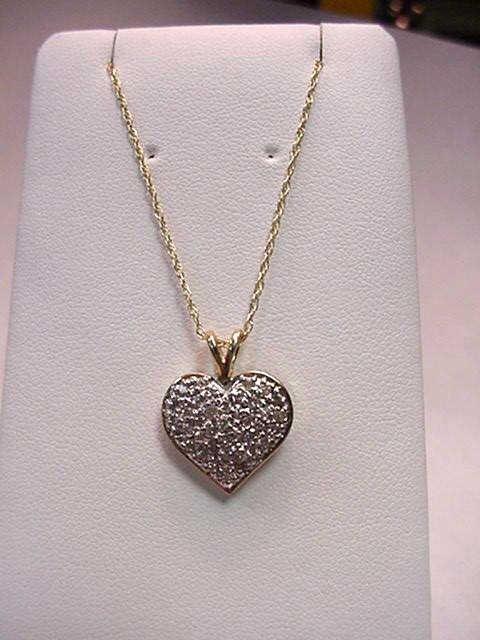 12: 14kyg pave heart necklace .50ctwq
