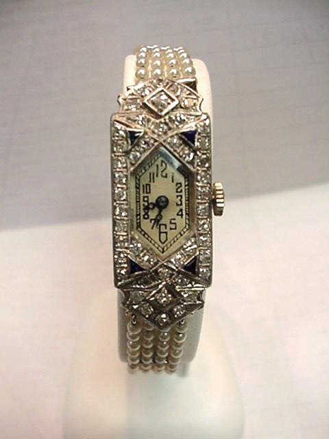 98: Platinum & diamond watch with pearl bracelet