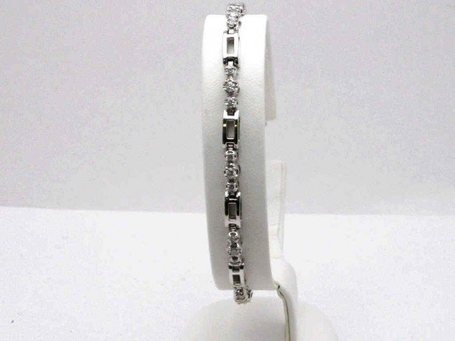5: 14kwg diamond bracelet 9 grams