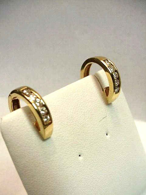 12: 14kyg diamond hoop earrings