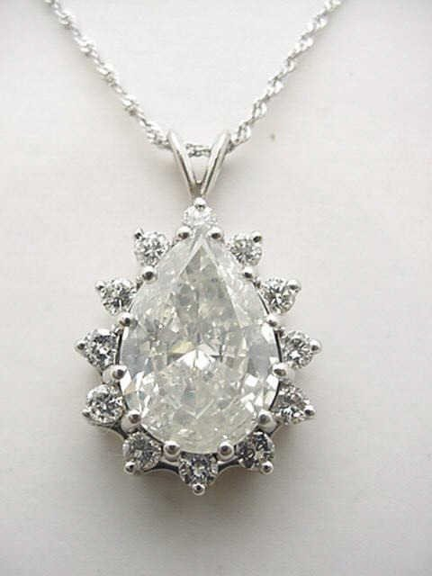 123A: 6.80ct pear shaped diamond pendant