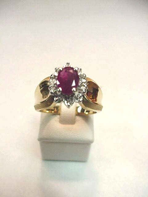 10: Lady's 14kyg ruby & diamond ring