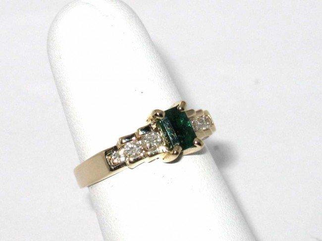 10: 14kyg emerald & diamond ring