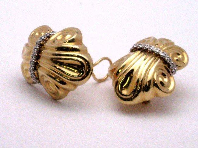 19: 14kyg fancy diamond earrings 10gr