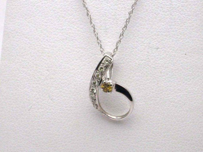 12: 18kwg fancy yellow diamond necklace