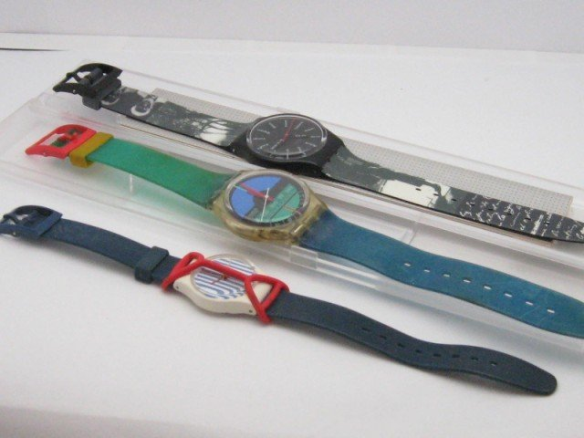 15: 3 Swatch watches