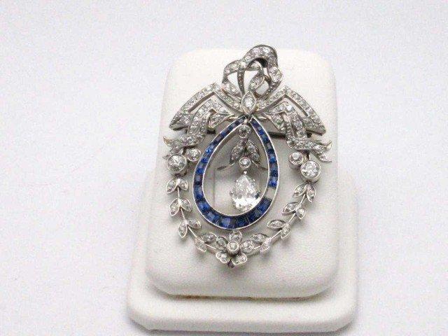28: Platinum diamond & sapphire brooch