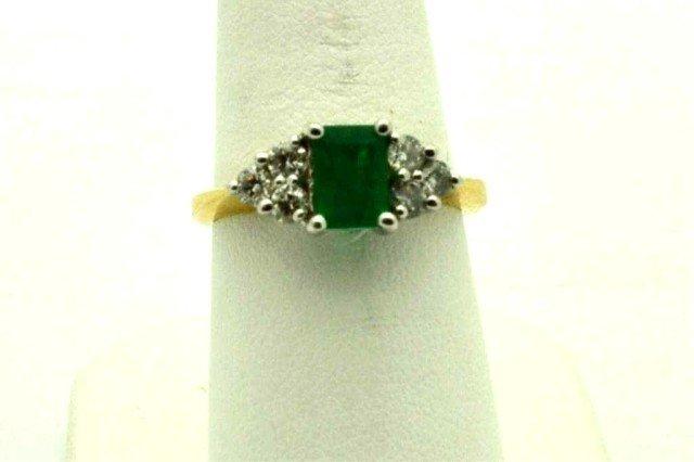 11: 14kyg emerald & diamond ring