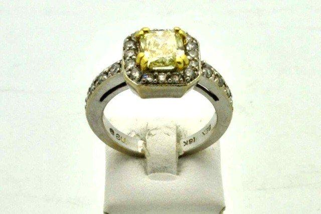 61: 18kwg fancy yellow diamond ring 1.54ct