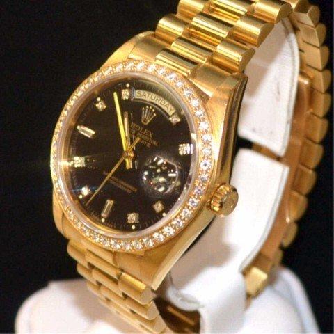 12A: Man's 18kyg Rolex President with diamonds