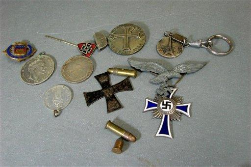 73: Lot of WWII - Nazi Memorabilia - medals, pins