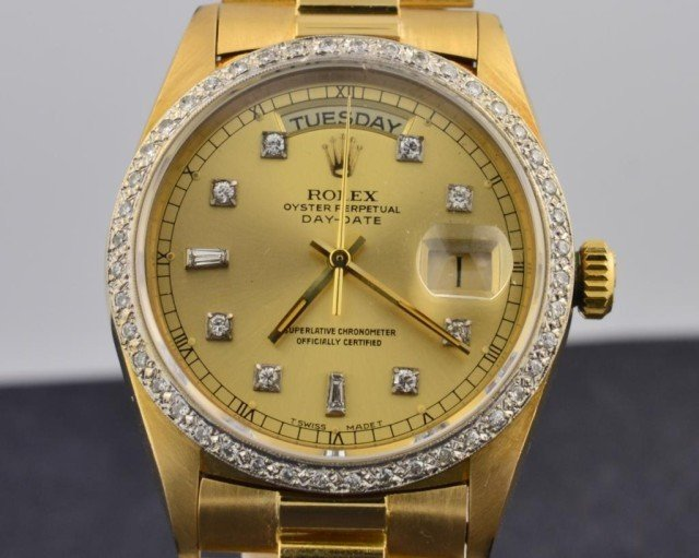 10: 18k yg  Rolex Watch  Mans Diamond Dial President