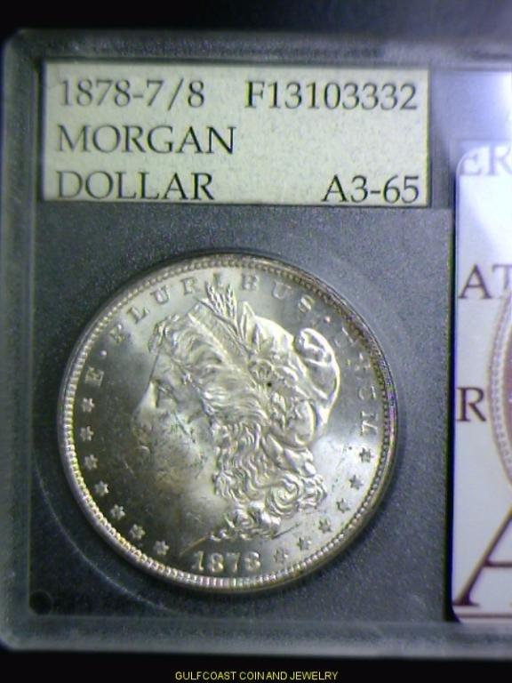 963: 1878 7/8 Morgan Silver Dollar Accugrade A3-65