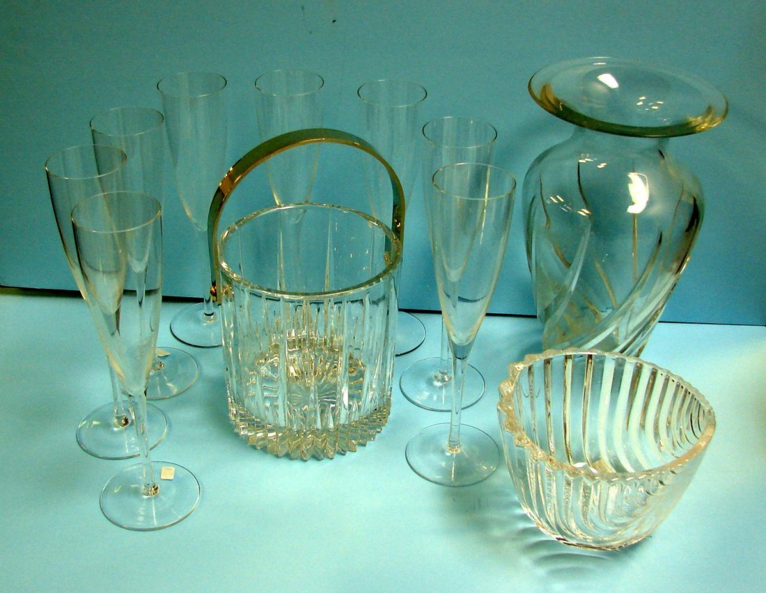 12: Crystal Vase, bowl, ice bucket, 8 Champagne Flutes