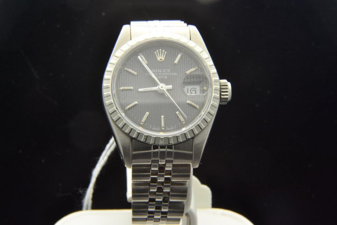 19: Stainless Steel Rolex Lady's Watch