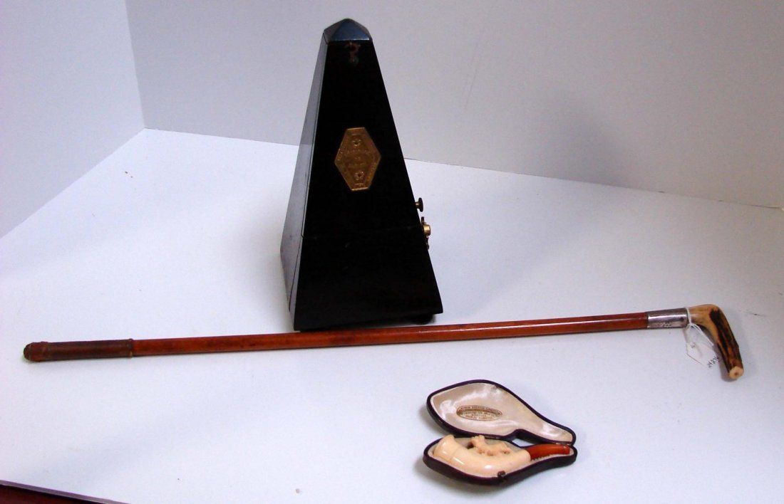 18: Antique Riding Crop, Carved Ivory Pipe, Metronome