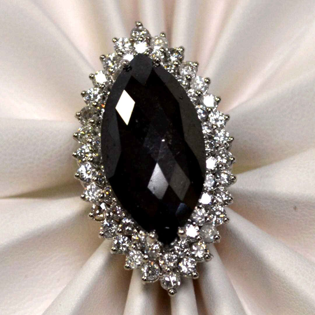 226: 12ct marquise shaped black diamond ring