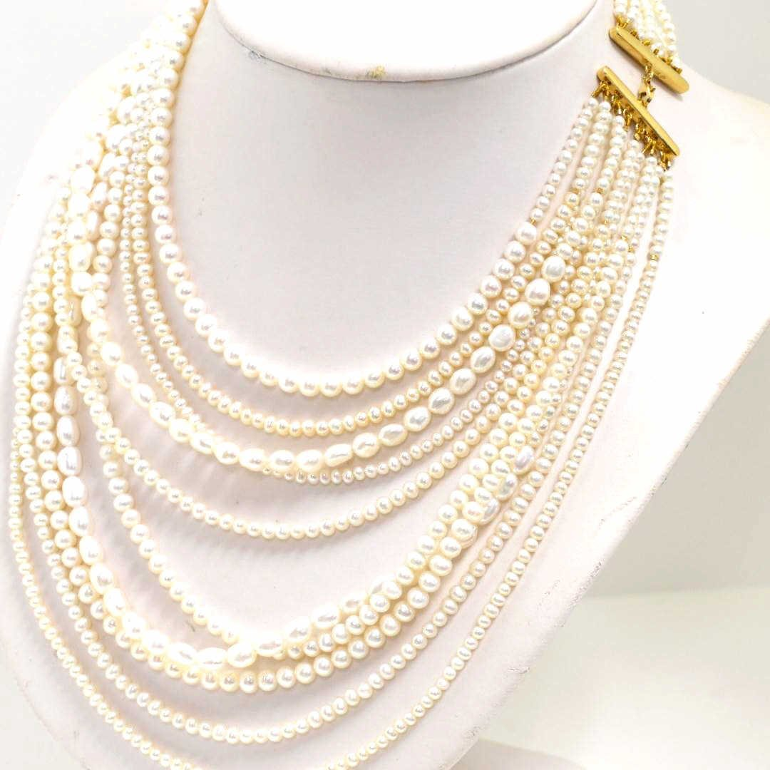 87: 9 strand White Freshwater Pearl Necklace