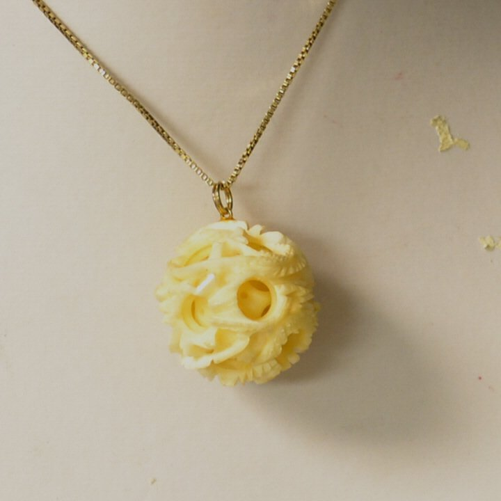 Carved Ivory Ball On Sterling Chain
