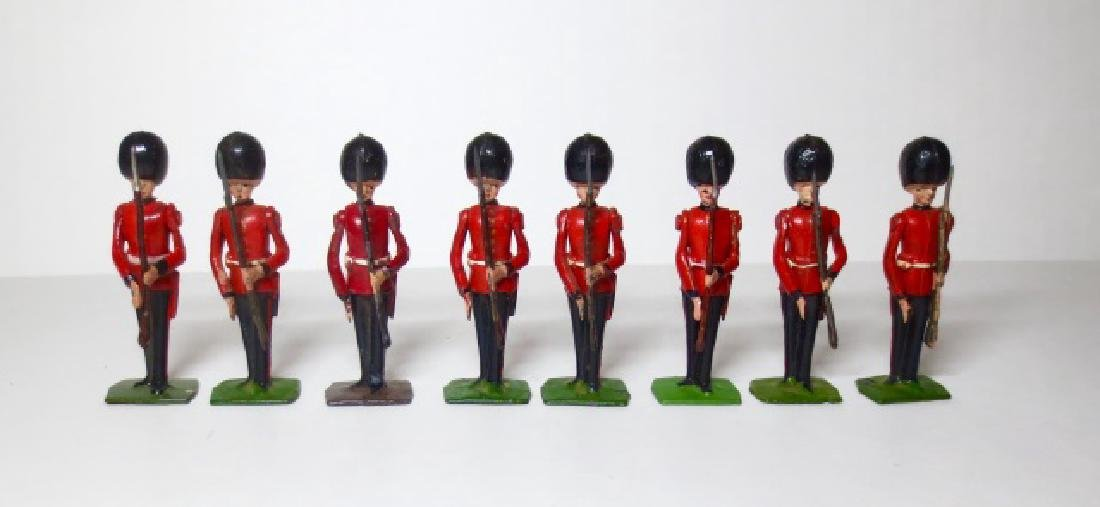 Britains Scots Guards Present Arms