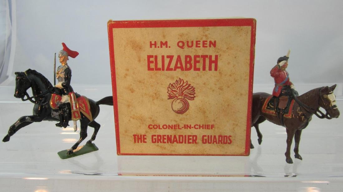 Britains Queen Elizabeth & HorseGuard Officer.