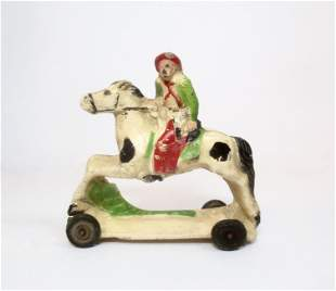 Auburn Rubber #A48 Cowboy on Wheeled Horse