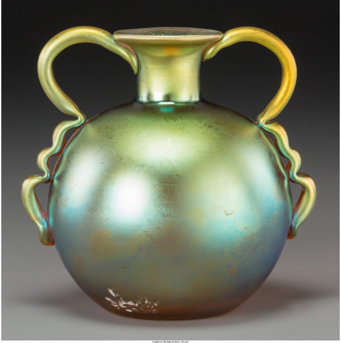 65392: An Austrian Iridescent Studio Glass Handled Cabi