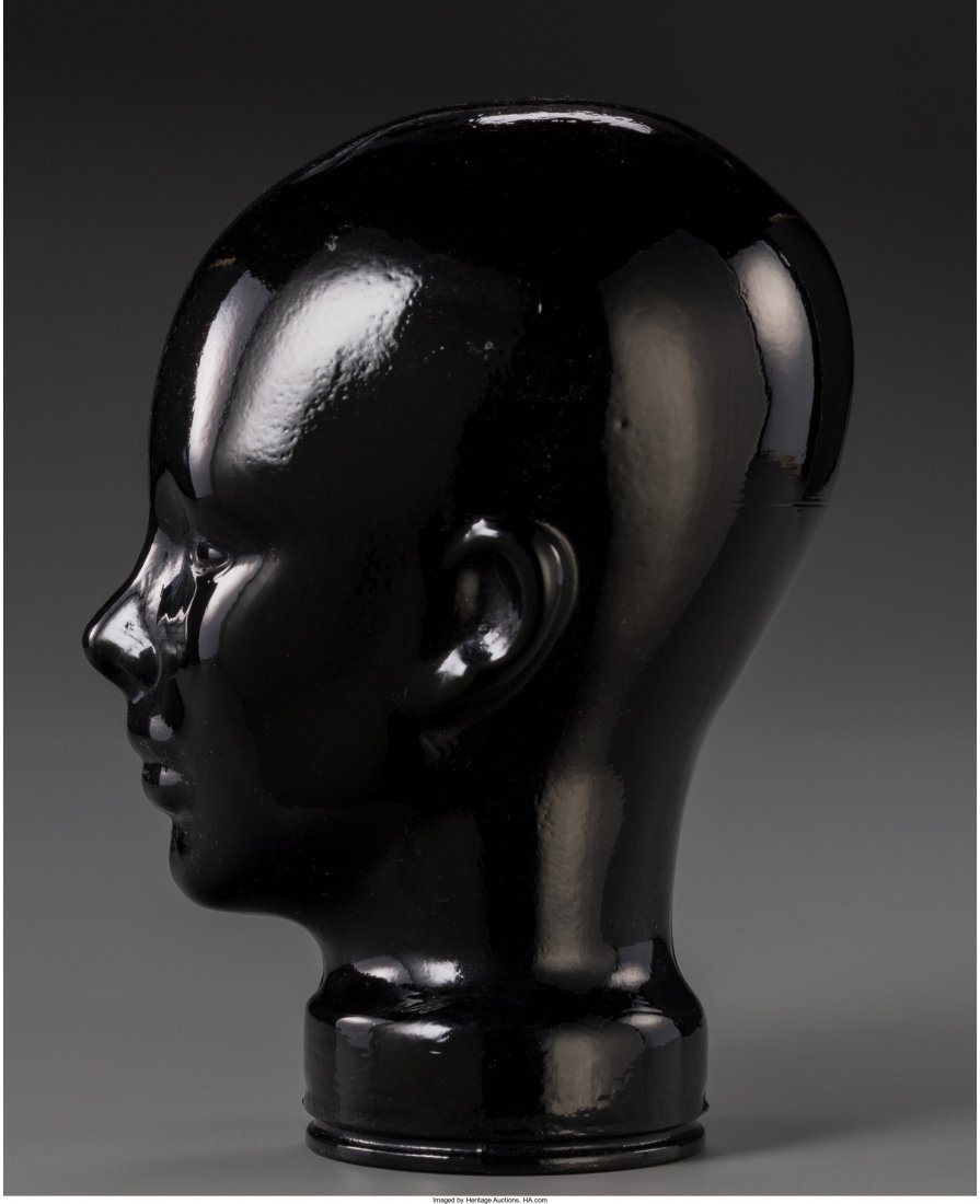 65870: A Molded Black Glass Head-Form Hat Stand, 20th c