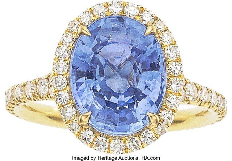55009: Ceylon Sapphire, Diamond, Gold Ring  The ring fe