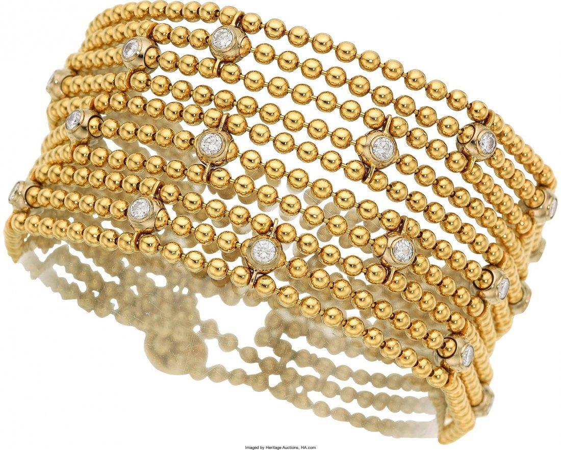 55015: Diamond, Gold Bracelet, Cartier  The multi-stran