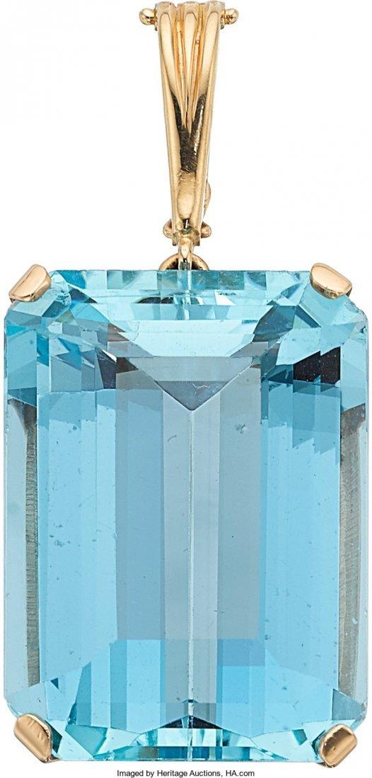 55024: Aquamarine, Gold Pendant  The pendant features a