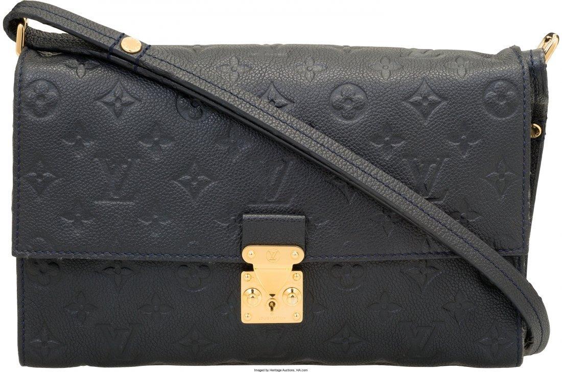 58021: Louis Vuitton Navy Monogram Empreinte Leather Fa