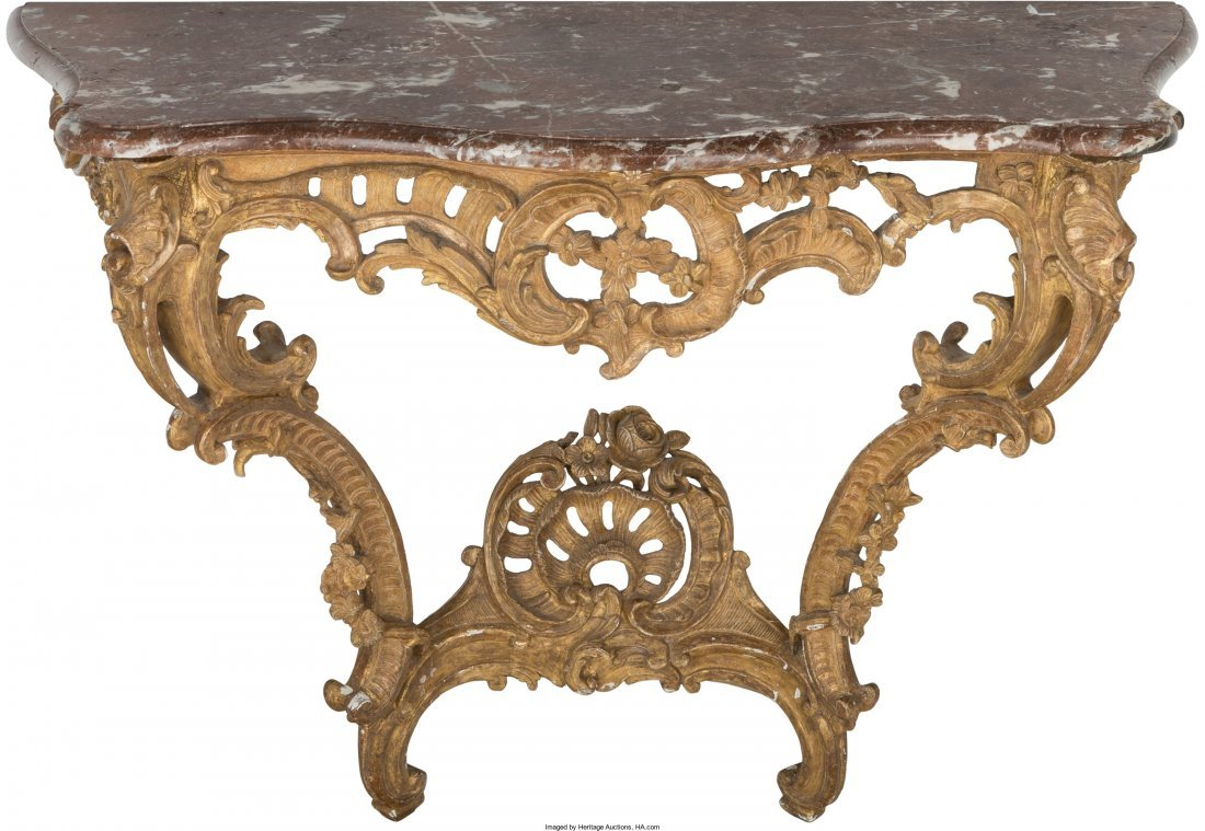 61001: A French Régence Carved and Giltwood Console wi