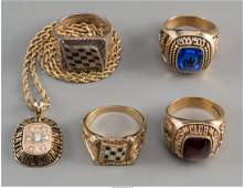 Four 18K 14K 10K Gold and Silvered Automobilia Rings