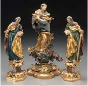 Three Continental Gilt and Polychrome Carved Wood and