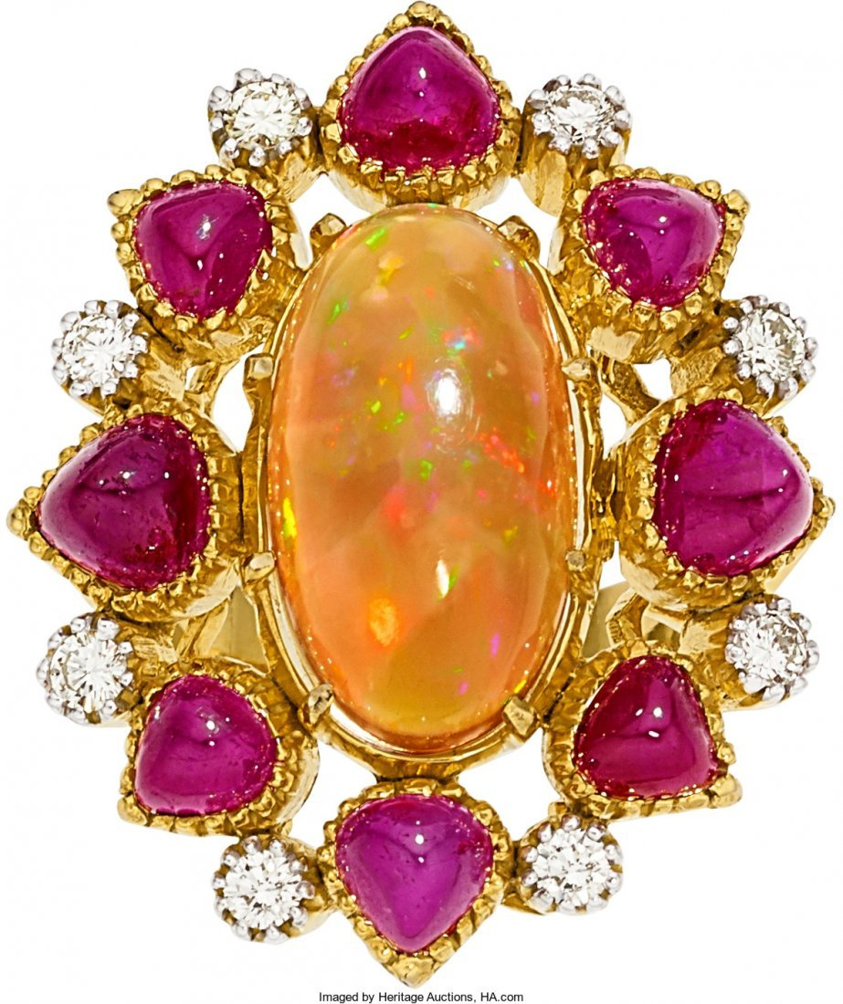 55019: Opal, Diamond, Ruby, Gold Ring  The ring centers