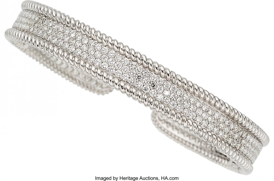 55065: Diamond, White Gold Bracelet   The cuff features