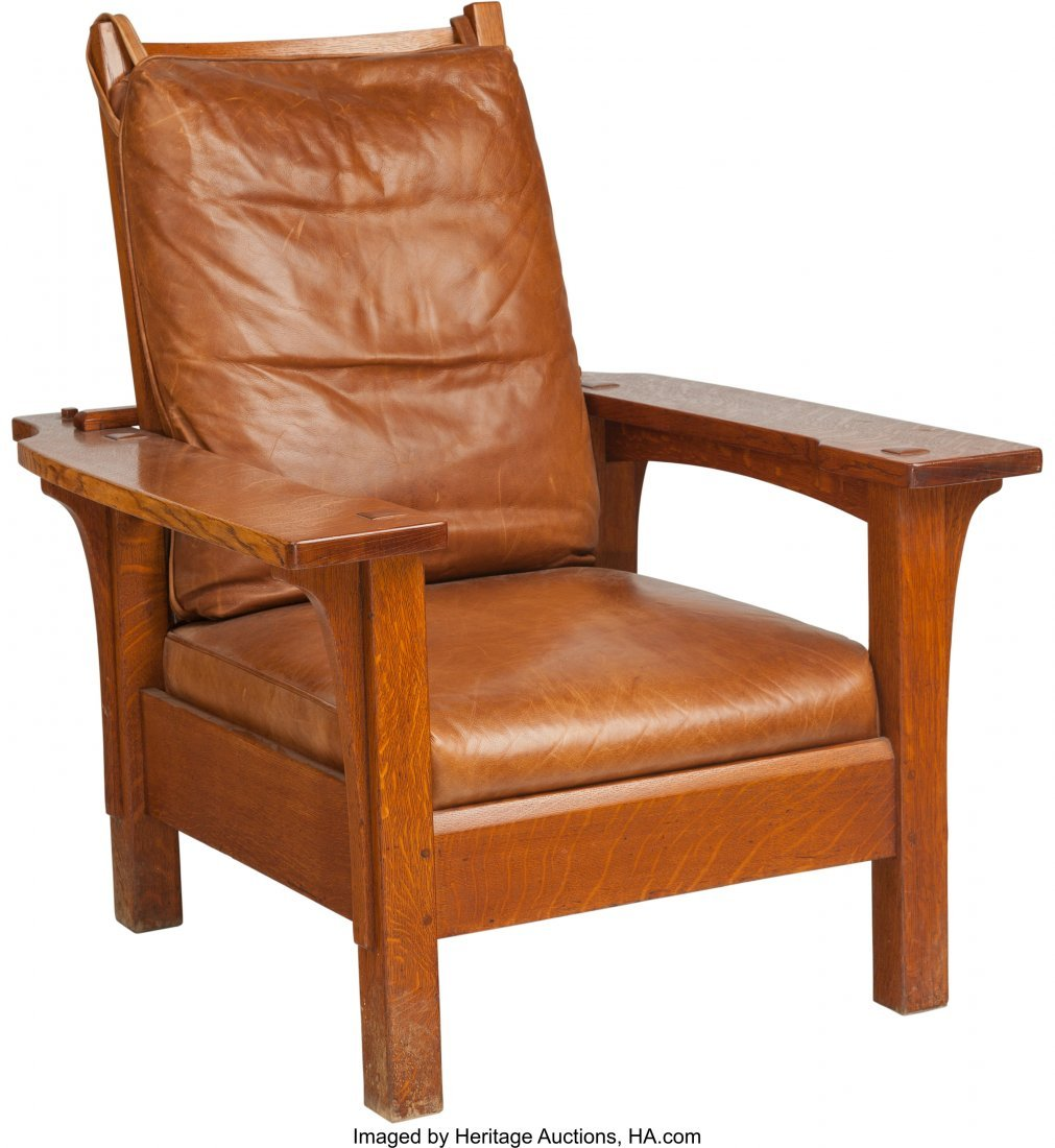 a stickley oak morris chair with leather cushion
