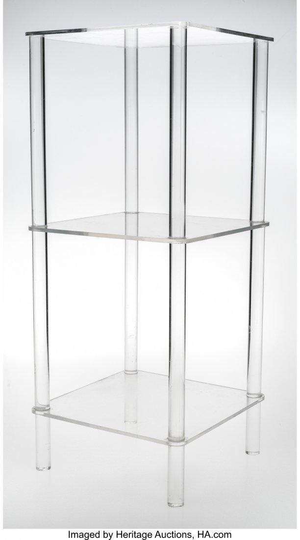 a threeshelf plexiglass display stand in