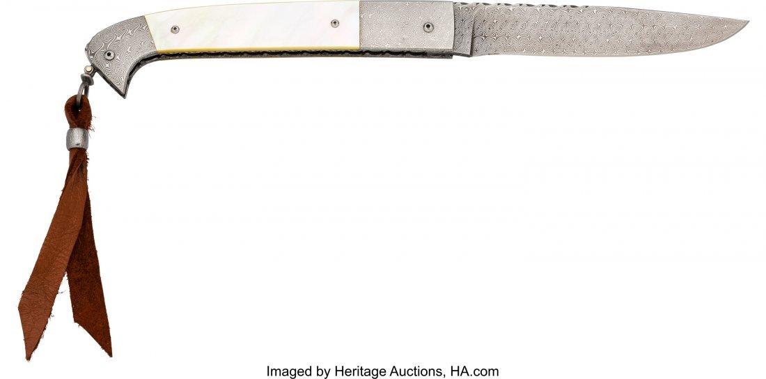40442: Jerry Rados Damascus Lock Blade Folding Knife.