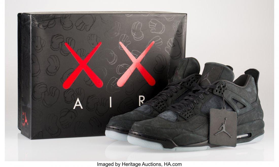 14046: KAWS X Nike Air Jordan 4, 2017 Black sneakers wi