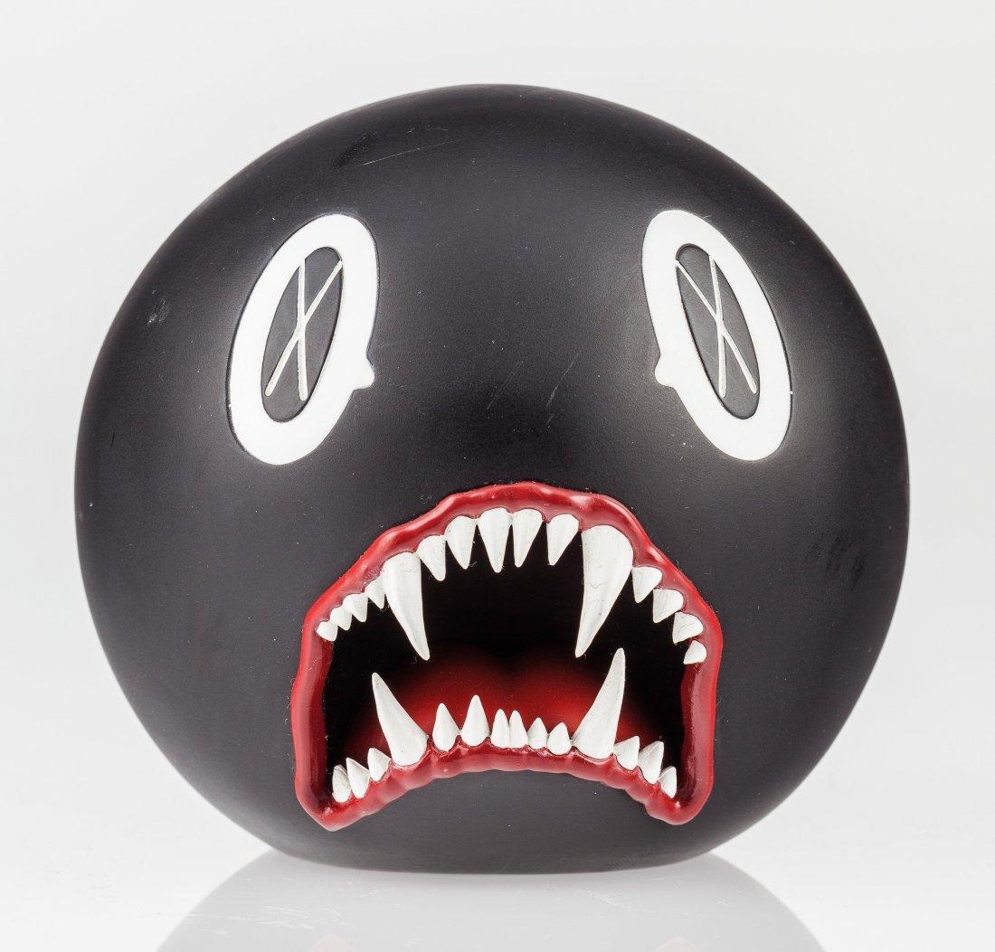 14021: KAWS (American, b. 1974) Cat Teeth Bank (Black),