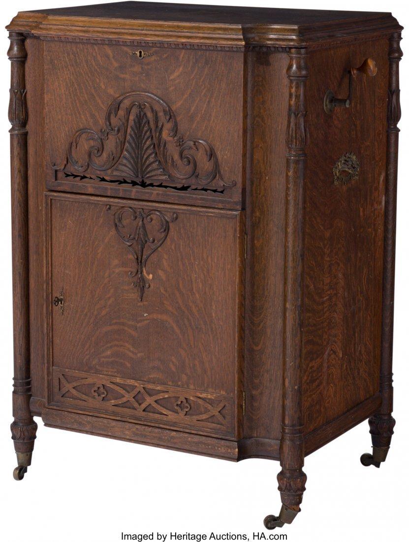 63087: A Mira Disk Music Player in Original Oak Cabinet