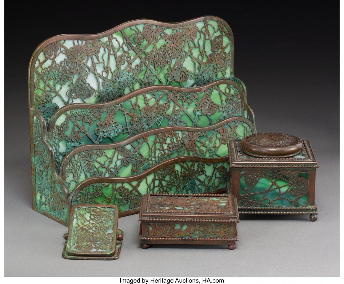 63351: A Four-Piece Tiffany Grapevine Pattern Bronze &