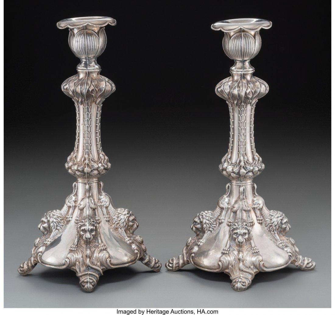 63138: A Pair of Austrian Silver Figural Candlesticks,