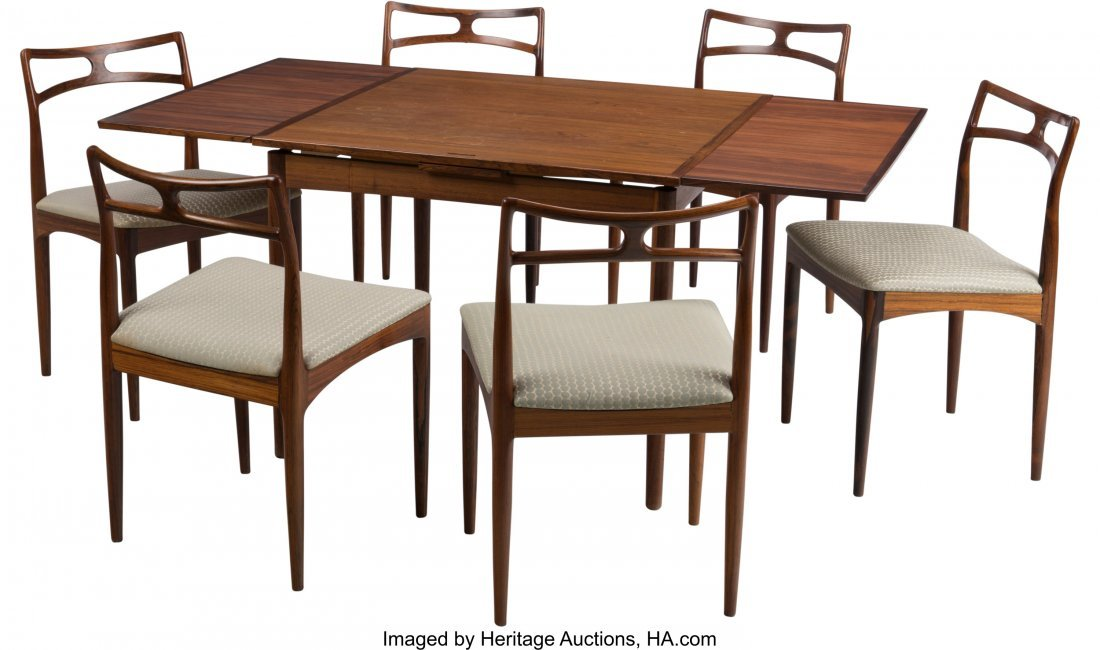 63310: A Seven-Piece Danish Dining Suite with Convertib