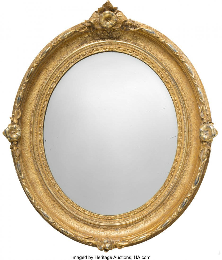 63071: An American Rococo Revival Oval Giltwood Mirror,