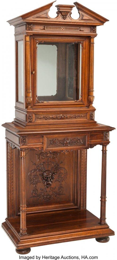 63072: A Renaissance Revival Walnut Vitrine Cabinet and
