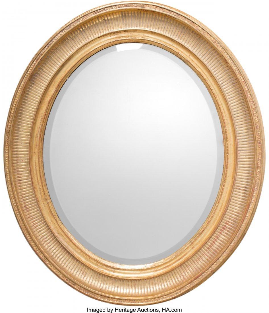 63247: A Neoclassical Oval Giltwood Mirror, circa 1900
