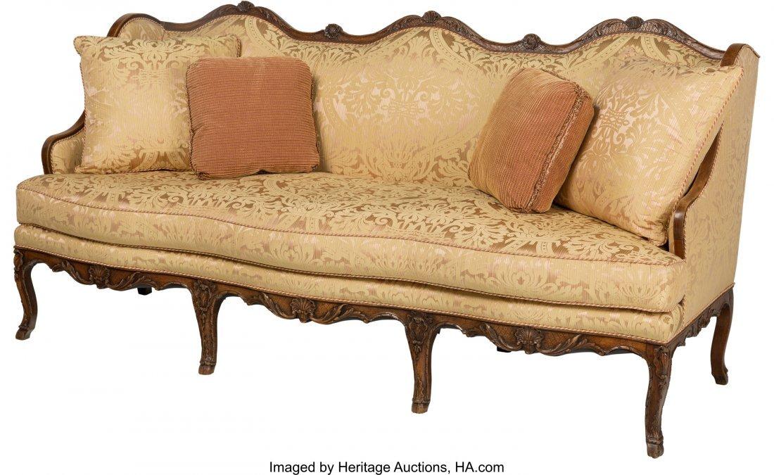 63421: An Italian Rococo-Style Walnut Sofa, late 18th-e